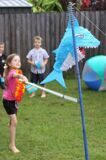 surf-themed-surfs-up-idea-birthday-party-beach-shark-pinata